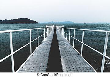 White boat jetty reaching into the sea, Naoshima, Japan