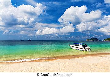 White boat on a beautiful beach