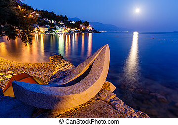 White Boat on the Beach and Transparent Mediterranean Sea in the Night, Croatia