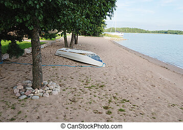 white boat on the beach