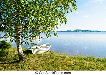 White boat on the lake.