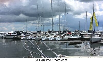 White boats moored on pier in Sopot city, Poland. Summer...