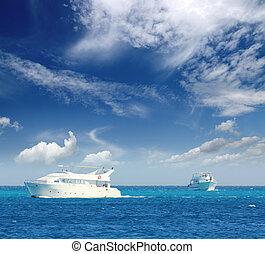 white boats sailing on turquoise sea