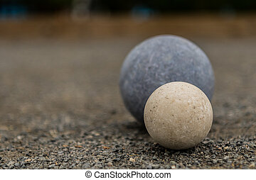 White Bocce Ball with Blue Ball Close Copy Space Left