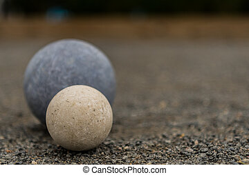 White Bocce Ball with Blue Ball Close Copy Space Right