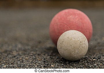 White Bocce Ball with Red Ball Close Copy Space Left