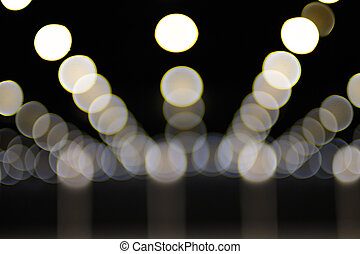 White bokeh on black background.