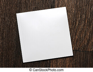 white-book on a wooden background