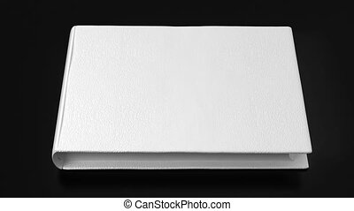 White book on black table