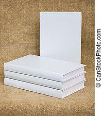 White books on the textile background