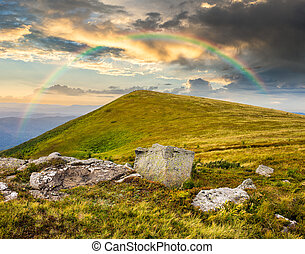 white boulders on the hillside at sunrise - composit...