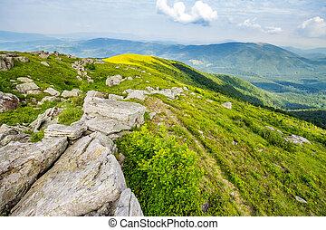 white boulders on the hillside - landscape with white sharp...