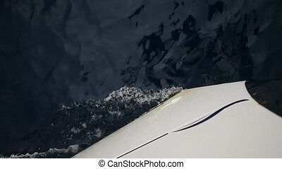 White bow on background of sea waves in Greece. Regatta....