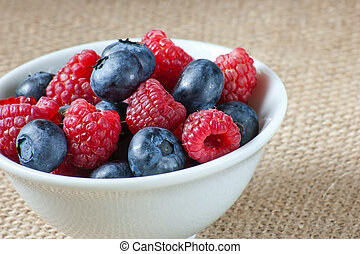 white bowl with fresh berries
