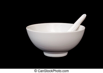White bowl with spoon isolated on black background