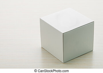 White box mock up on wooden background
