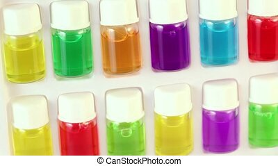 White box rotates with set of color oil in bottles - White...
