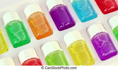 White box spins with set of color oil in bottles - White box...