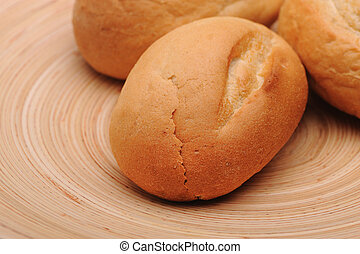 White bread on a round wooden plate