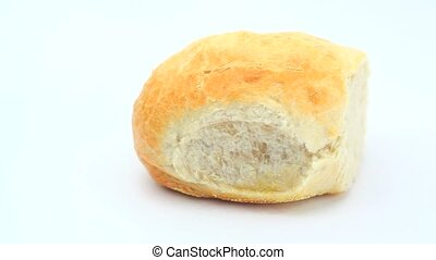 White bread roll rotating on a white background