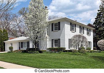 White brick home in spring