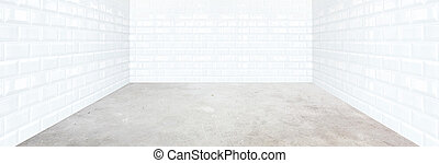 white brick tile room with cement floor