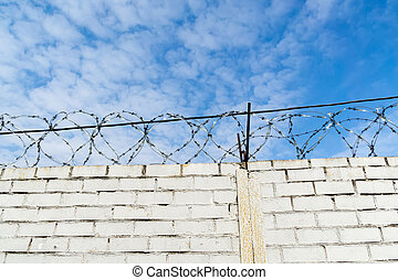 White Brick Wall and Barbed Wire
