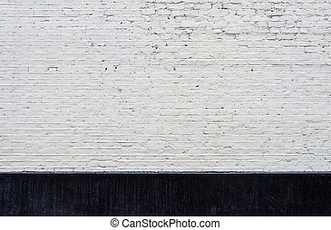 White brick wall and black skirting