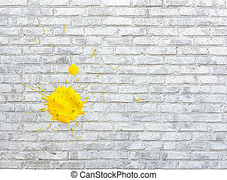 White brick wall stained spots of paint of yellow colors