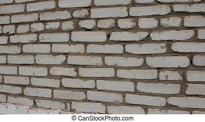 White brick wall. Steadicam, HD