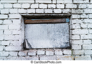 White brick wall with a window, building structures, abandoned building
