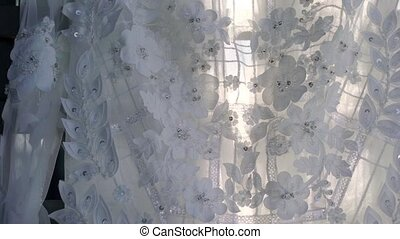 White bridal dress closeup steadicam