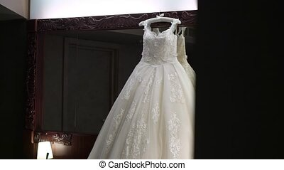White bridal dress in bedroom