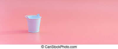 White bucket on a pink background with space for text