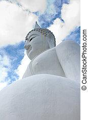White Buddha statue with blue sky