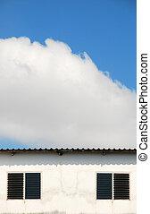 white building on a blue sky