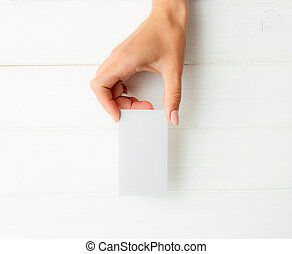 White business card in girl hands