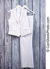 White business outfit. Female business suit with trousers. ...