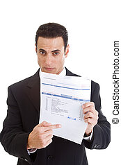 White businessman pointing to a past due medical bill.  Isolated on white background.