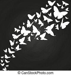 White butterflies silhouettes on chalkboard
