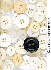 White buttons & black button