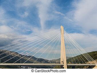 White Cables Over Span of Suspension Bridge