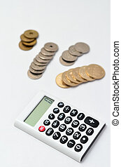 White Calculator and japanese coin isolated on white background.
