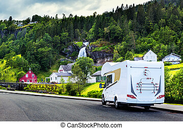 White camper near Steinsdalsfossen waterfall