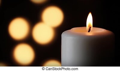 White Candle and Lights Loop - Loop with a large white...