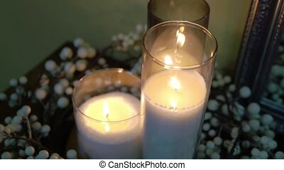White candles at the party decorated
