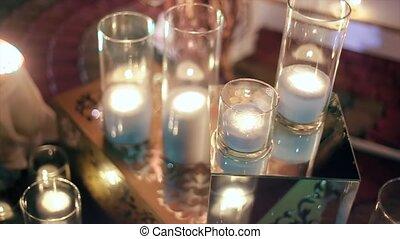 White Candles, Firewood Lamp Near Brick Fireplace