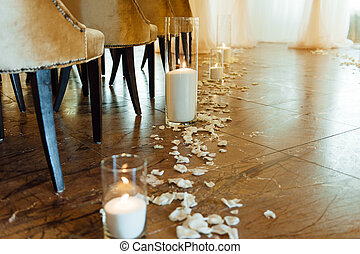 white candles in vase on the floor for ceremony