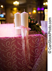 candles tied with a pink ribbon