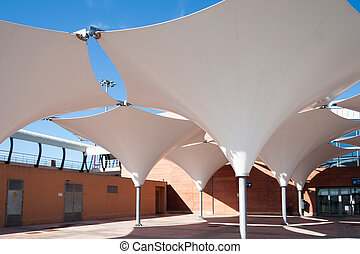 White Canopy near building at sunny day